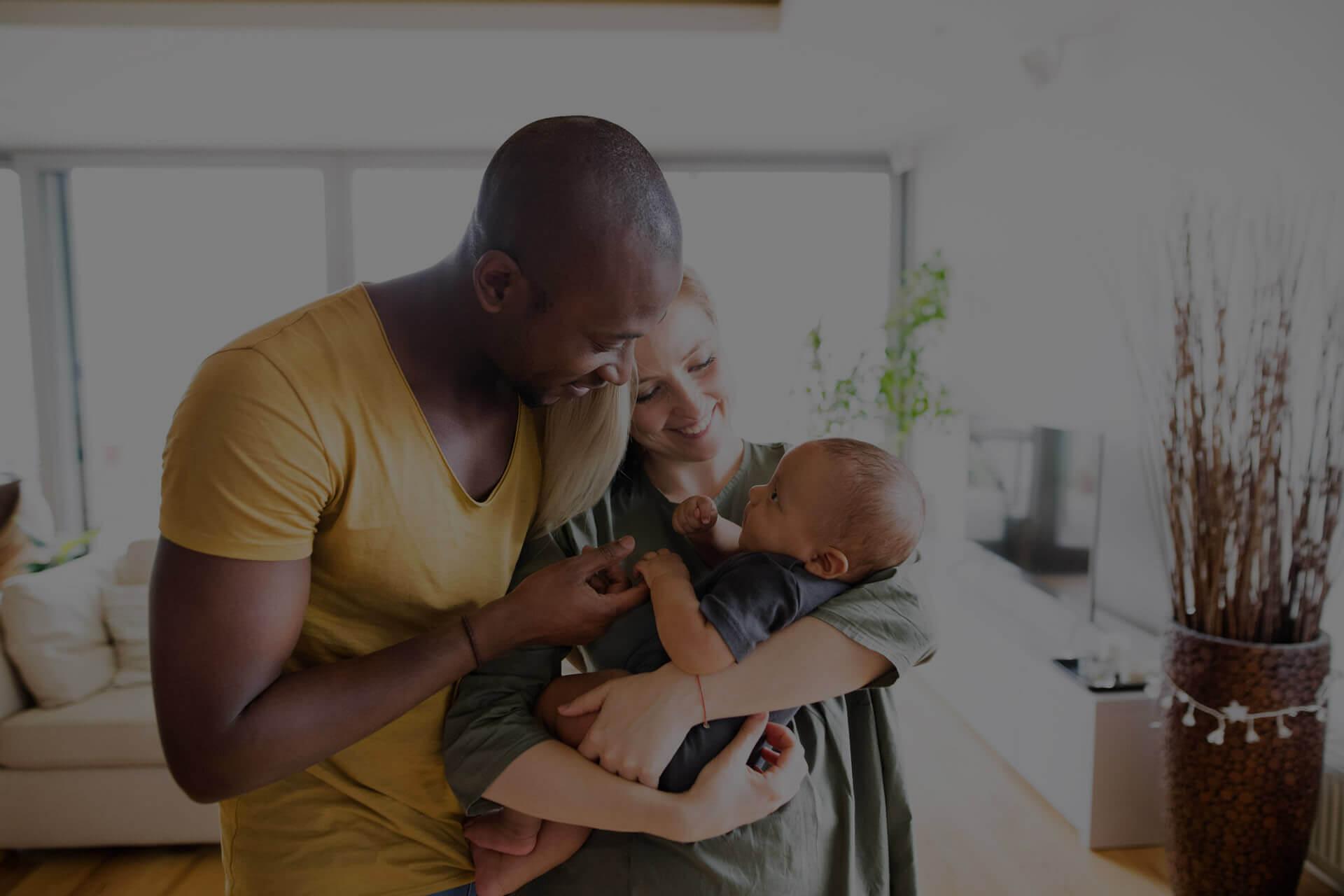 Parents holding infant son