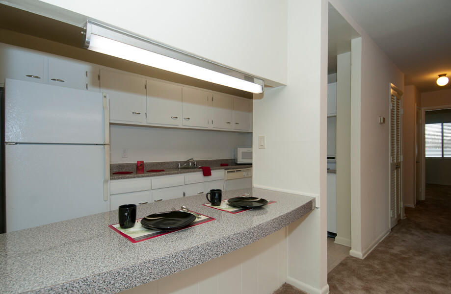 Auden Place kitchen with white cabinets and appliances