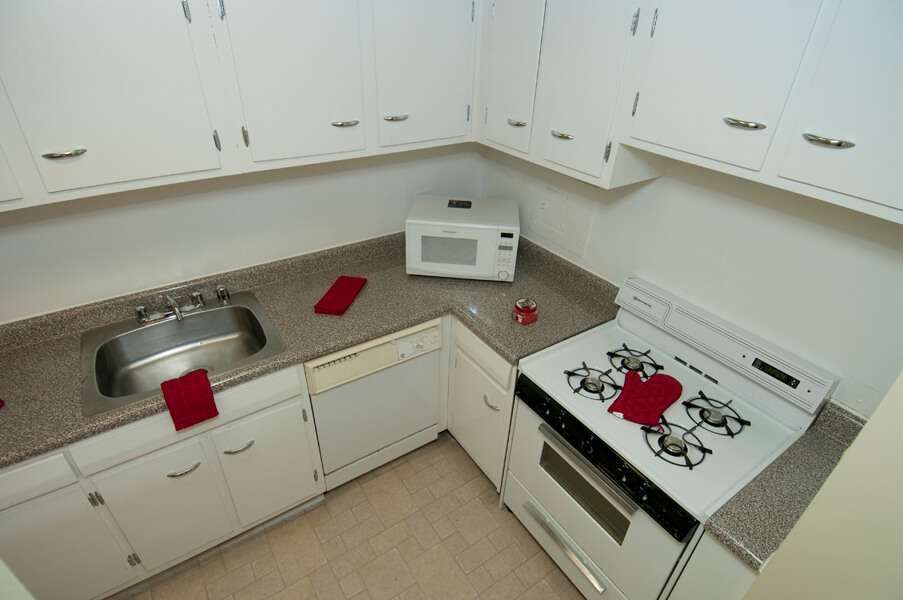 Auden Place kitchen with white cabinet and appliances